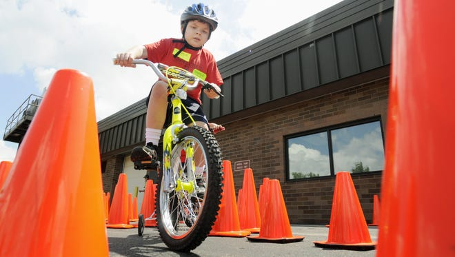 Charlie Duellman goes through the obstacle course to learn bike safety in the Safety City II program at Fox Valley Technical College's Riverside Campus in this 2008 file photo.