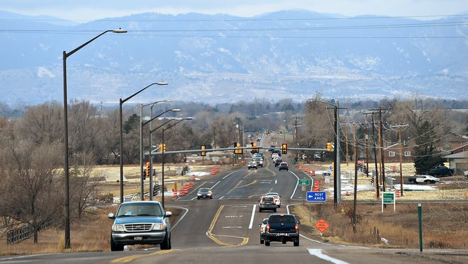 Traffic travels Prospect Road just west of Interstate 25 on Dec. 16, 2016, in Fort Collins.