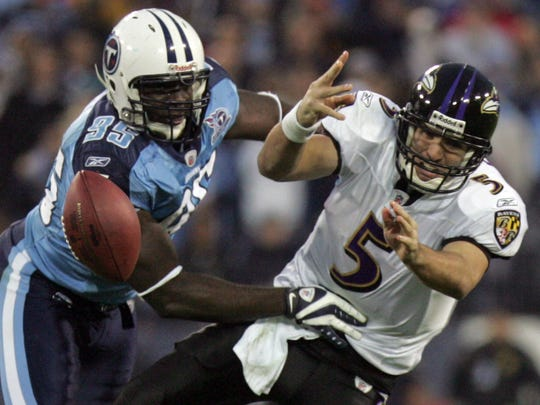 Titans defensive end William Hayes (95) hits Ravens quarterback Joe Flacco (5) in the first half of a game Jan. 10, 2009.