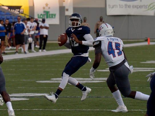 Jackson State University quarterback Brent Lyles, 12,