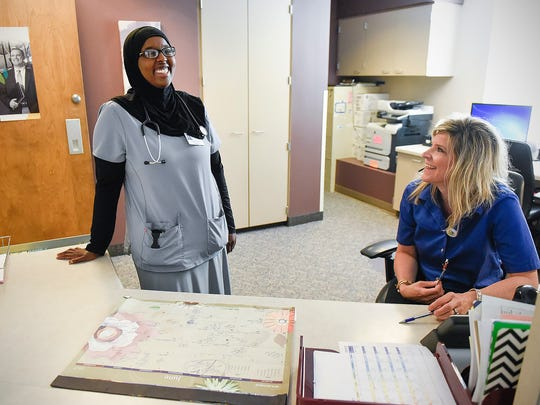 Mulki Habad, respiratory care, talks with respiratory care administrative supervisor Jen Brreth Thursday, June 8, 2017 at the St. Cloud Hospital.