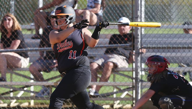 Marlboro's Danielle Macrario (11) smacks a hit against Red Hook during girls softball action at Recreation Park in Red Hook April 28,  2017. Marlboro won the game.