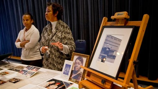 Mary Mundy, senior archives specialist, left, and Maricia Battle, curator, prints and photographs division, explain items in the Rosa Parks archive to members of the media during a media preview at the Library of Congress, Madison Building, in Washington on Jan. 29.