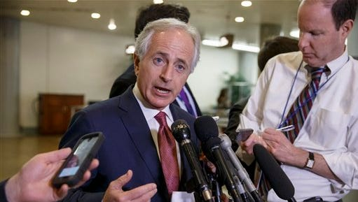 FILE - In this Feb. 10, 2015 file photo, Senate Foreign Relations Committee Chairman Sen. Bob Corker, R-Tenn. speaks to reporters on Capitol Hill in Washington. Two years ago, Corker wondered aloud whether the standstill Senate was worth a grown man's time. But Republicans' political fortunes in last November's elections and brutal terrorism overseas have put the two-term Tennessee lawmaker in the chairmanship of the storied Foreign Relations Committee and in charge of the weightiest choices to ever face lawmakers: whether to vote to authorize war. The high-stakes role of negotiating President Barack Obama's request for new authority to destroy Islamic state militants is a test for the affable businessman and former Chattanooga mayor.  (AP Photo/J. Scott Applewhite, File)