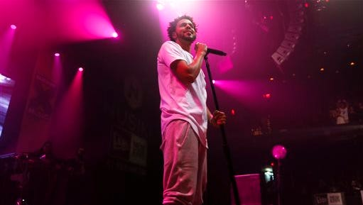 FILE - In this March 21, 2015, file photo, J Cole performs at the ACL Moody Theater during the SXSW Music Festival in Austin, Texas. Authorities say a shooting happened late Monday, Aug. 3, outside the PNC Bank Arts Center in Holmdel, N.J., where hip hop artists J. Cole and Big Sean performed at the venue. (Photo by Jack Plunkett/Invision/AP, File)