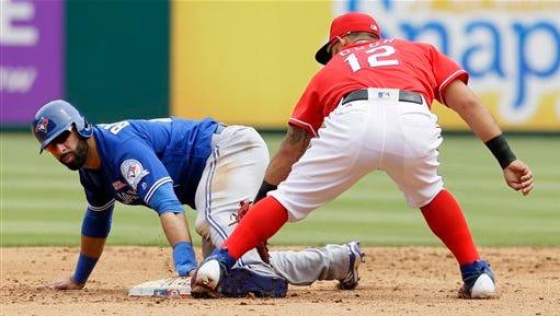 Toronto Blue Jays Jose Bautista, left, steals second base against Texas Rangers second baseman Rougned Odor during a baseball game in Arlington, Texas, Sunday.