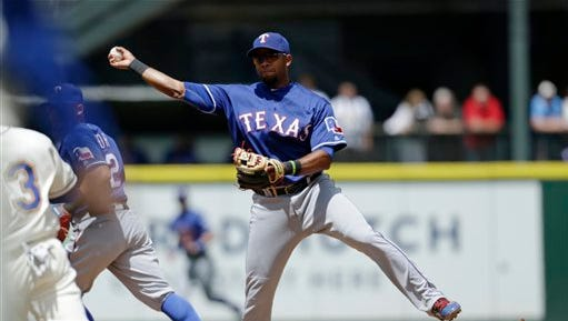 Texas Rangers shortstop Elvis Andrus forces Seattle Mariners' Chris Iannetta out at second while making the throw to first in a failed double play attempt during the third inning of a baseball game Sunday.