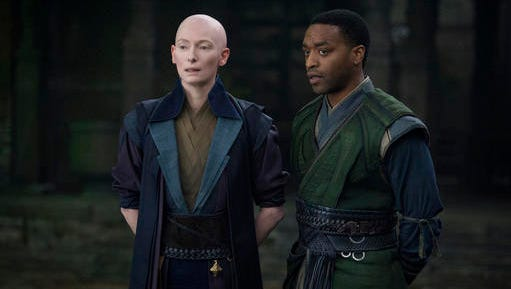 "This image released by Disney shows Tilda Swinton, left, and Chiwetel Ejiofor in a scene from Marvel's ""Doctor Strange."""