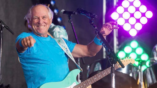 """FILE - This July 29, 2016 file photo shows Jimmy Buffett performing on NBC's """"Today"""" show in New York. The Jimmy Buffett musical will premiere in California and will make stops in New Orleans, Houston and Chicago before docking on Broadway by spring of 2018. """"Escape to Margaritaville,"""" combining Buffett's tunes with an original story by writers Greg Garcia and Mike O'Malley, will start grooving onstage in May 2017 at La Jolla Playhouse."""