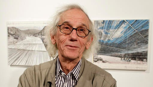 "FILE - In this Wednesday, Jan. 23, 2013 file photograph, artist Christo responds to questions during a show of sketches and photos of some of his in-progress works at the Metropolitan State University Center for Visual Art in Denver. Christo and his late wife, Jeanne-Claude, had won state and federal permits to build a project called ""Over the River,"" which would have involved the suspension of nearly six miles of giant fabric panels from anchors and cables over parts of a 42-mile stretch of the Arkansas River next to U.S. Highway 50. On Wednesday, Jan. 25, 2017, Christo announced that he has abandoned plans to complete the project."