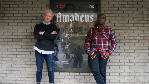 Lucian Msamati and Adam Gillen, left, the stars of the theatre play Amadeus, pose for a photograph in London, Monday, Jan. 30, 2017. Britain's National Theatre has a sold-out hit with a revival of Peter Shaffer's play about bad-boy genius Wolfgang Amadeus Mozart, played by Gillen, and his jealous rival Antonio Salieri, played by Msamati, composer to the 18th-century Viennese court.