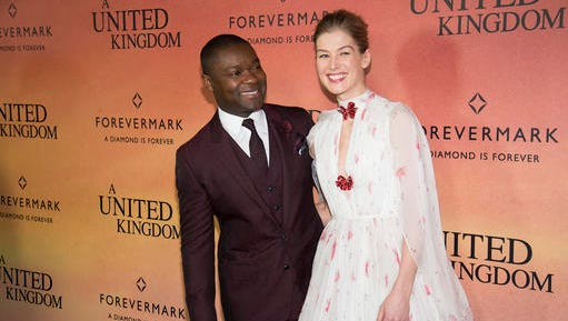 "David Oyelowo, left, and Rosamund Pike attend the world premiere of Fox Searchlight's ""A United Kingdom"" at the Paris Theatre on Monday, Feb. 6, 2017, in New York. (Photo by Charles Sykes/Invision/AP)"