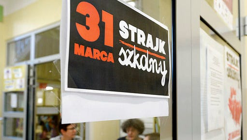 """A poster at  the door in a school  reeads:   """"School Strike March 31"""" in Warsaw, Poland, on Friday March 31, 2017. Teachers across Poland staged a strike Friday to protest a sweeping overhaul of the education system by the populist government that will see middle schools eliminated this coming fall."""