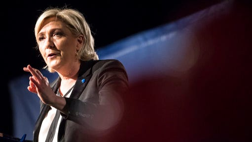 Far-right candidate for the presidential election Marine Le Pen speaks during a campaign meeting in Monswiller near Strasbourg, eastern France, Wednesday, April 5, 2017. A self-described patriot, Le Pen hopes to extract France from the European Union and do away with France's membership in the shared euro currency. The two-round presidential election is set for April 23 and May 7.