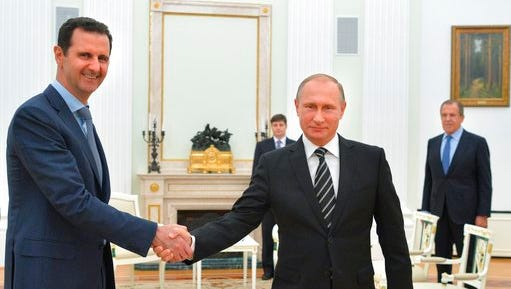 """FILE - In this Tuesday, Oct. 20, 2015 file photo, Russian President Vladimir Putin, center, shakes hand with Syrian President Bashar Assad as Russian Foreign Minister Sergey Lavrov, right, looks on in the Kremlin in Moscow, Russia. U.S. Secretary of State Rex Tillerson's statement Tuesday, April 11, 2017, that the reign of President Bashar Assad's family """"is coming to an end"""" suggests Washington is taking a much more aggressive approach about the Syrian leader. Taking him out of the equation without a clear transition plan would be a major gamble."""