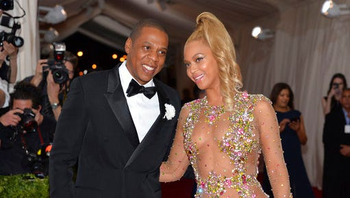 "File - In this May 4, 2015, file photo, Jay Z, left, and Beyonce arrive at The Metropolitan Museum of Art's Costume Institute benefit gala celebrating ""China: Through the Looking Glass"" in New York. Country music power couple Faith Hill and Tim McGraw talk about what they admire about other musical couples, from Beyonce and Jay Z to Garth Brooks and Trisha Yearwood. ""The truth is, I want to be Beyonce every single freaking night of my life,"" Hill said."