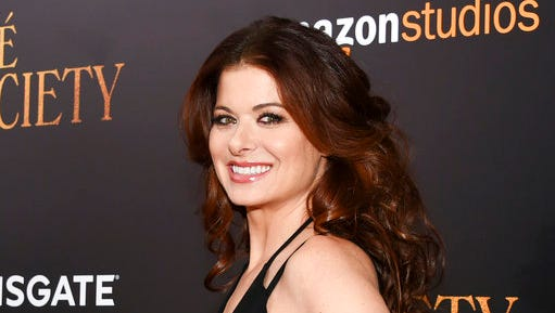 """FILE - This July 13, 2016 file photo shows actress Debra Messing at the premiere of """"Cafe Society"""", in New York. Messing will be honored May 6 at the GLAAD Media Awards as a champion against discrimination."""