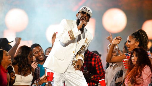 FILE- In this Nov. 6, 2015, file photo, R. Kelly performs during the 2015 Soul Train Awards at the Orleans Arena in Las Vegas. A Mississippi sheriff's deputy is suing singer R. Kelly, alleging that Kelly had a yearslong affair with his wife that broke up his marriage. Representatives of the rhythm and blues crooner, whose full name is Robert Sylvester Kelly, didn't immediately return requests for comment Thursday, April 27, 2017.