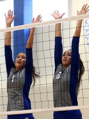 Lake View's Erin Valdez, left, and Abbie Rivera defend the net