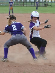 Unioto's Jayla Campbell (right) reaches third base