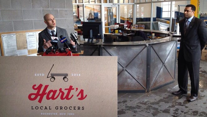 Officials speak at a news conference Jan. 10 announcing that Hart's Local Grocers is coming to the East End.