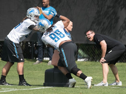 Lions defensive tackles Pat O'Connor, left, and Khyri