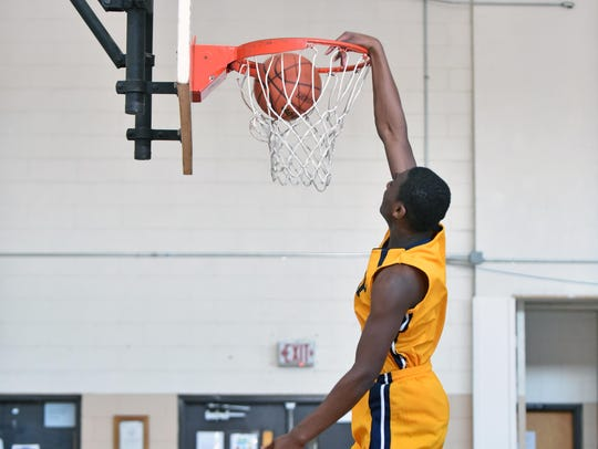 A member of the Vineland Preparatory Academy basketball