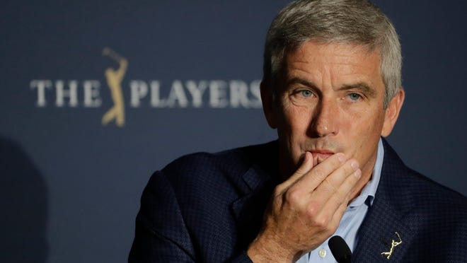 FILE - In this March 13, 2020, file photo, PGA Tour Commission Jay Monahan is shown during a news conference in Ponte Vedra Beach, Fla. Monahan decided against a public statement on the civil unrest sparked by the police killing of George Floyd, instead sending a letter to players.