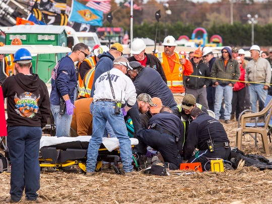 Paramedics tend to an injured person after a piece of metal flew off of an air cannon, striking them in the head, at the World Championship Punkin Chunkin in Bridgeville on Sunday afternoon.