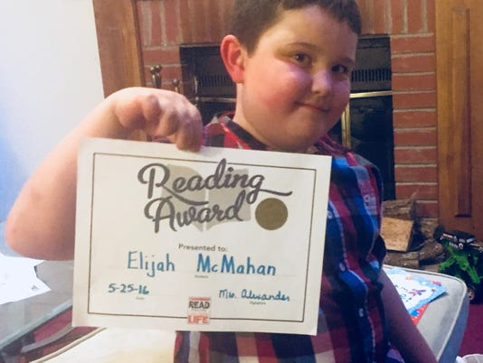 636486019472313222-Eli-reading-award.jpg