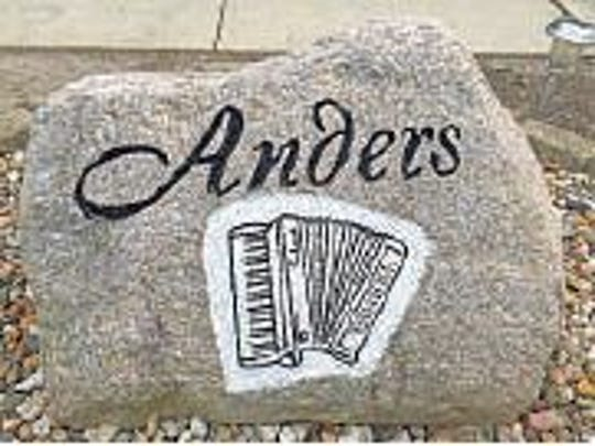 The stone outside of Don Anders' house in Newhall reflects his love for music.
