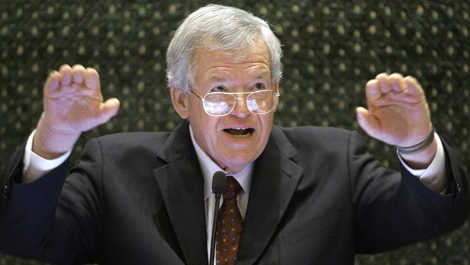 In this March 5, 2008 file photo, former U.S. House Speaker Dennis Hastert speaks to lawmakers on the Illinois House of Representatives floor at the state Capitol in Springfield, Ill. A federal judge on Tuesday delayed former U.S. House Speaker Dennis Hastert's first court appearance until June 9 following his indictment in Chicago. The Illinois Republican was scheduled to be arraigned Thursday, but the hearing has now been pushed back. The change was made without explanation in a one-sentence court filing by U.S. District Judge Thomas M. Durkin's clerk.