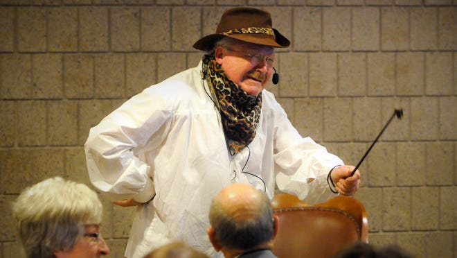 Chuck Chalberg entertains as Teddy Roosevelt during Thursday's Night at Your Museum fundraising event at the Stearns History Museum.
