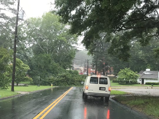 A tree pulled power lines down at the intersection