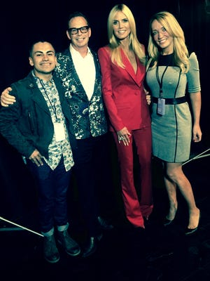 Brother Loves Fashion winner Gustavo Villalobos, far left, is pictured with, left to right, Dean F. Shulman, senior vice present at Bridgewater-based Brother International Corp.; super model Heidi Klum, and Nicole Larrauri, managing partner of the EGC Group.