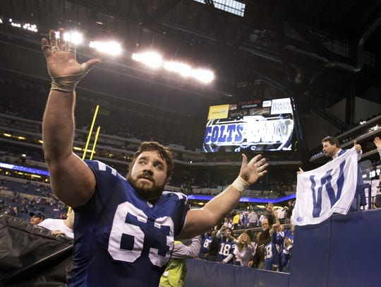 Indianapolis Colts' Jeff Saturday heads off the field