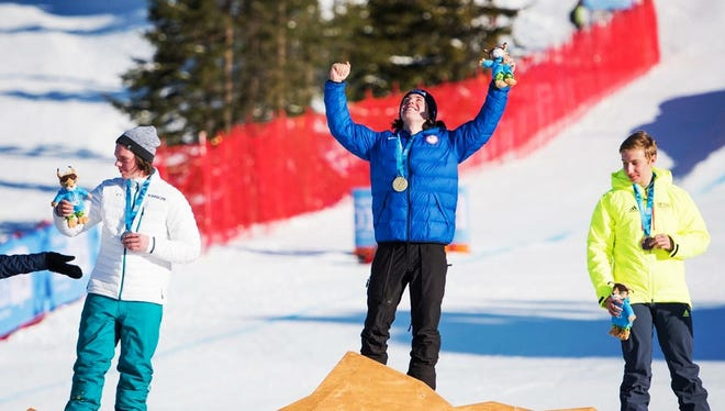 Jake Vedder (center) won a gold medal at the Winter Youth Olympic Games. After being named to the United States Olympic Development Team, he hopes to one day be a gold medalist for Team USA.