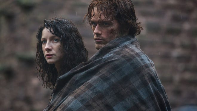 "Claire Randall (Caitriona Balfe) and Jamie Fraser (Sam Heugan) roam the Scottish Highlands in ""Outlander."""