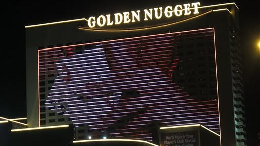 This photo shows the exterior of the Golden Nugget casino in Atlantic City N.J. In an action made public today, the New Jersey Division of Gaming Enforcement fined the casino $4,000 for handing a gambler a stack of chips to reimburse his losses after the casino realized it had used unshuffled cards for four games. Chips cannot be removed from gambling tables except in return for cash, credit or in other narrowly defined circumstances.