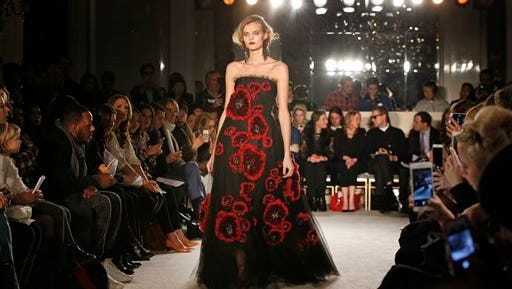 A model walks the runway in the Marchesa Fall 2015 fashion show in New York, Wednesday.
