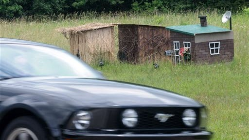 Three houses, one made of hay, one of sticks and one of bricks, have been constructed along U.S. Route 35 in Xenia Township west of Dayton, Ohio, Monday, June 15. An anonymous apparent fan of pigs and fairy tales is offering some shelter for any piglets still loose after a semitrailer crash last week in Southwest Ohio.
