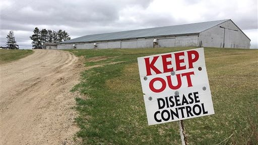 Sign warning visitors to stay away outside an infected turkey farm in Melrose, Minn.