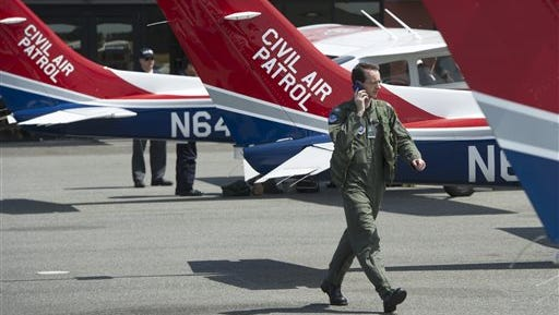 In this July 13, 2015 photo, Capt. John Haug of the Civil Air Patrol prepares to leave Bellingham, Wash. International Airport  in one of three patrol planes to search for a private plane that never reached Lynden, Wash.  A 16-year-old girl survived a small-plane crash that killed her step-grandparents in the rugged mountains of north-central Washington state and then hiked through thick forest to safety in what a rescuer called a miracle. (Philip A. Dwyer/The Bellingham Herald via AP) MANDATORY CREDIT