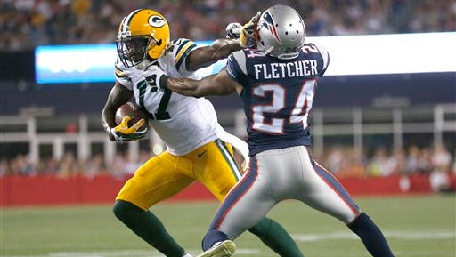 Green Bay Packers wide receiver Davante Adams  tries to escape the grasp of New England Patriots defensive back Bradley Fletcher (24) in the first half of a preseason football game on Thursday, Aug. 13, 2015, in Foxborough, Mass.