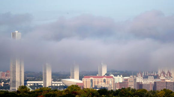 Morning fog burns off in downtown Albany on Wednesday, Oct. 5, 2016, as seen from across the Hudson River in East Greenbush, N.Y. New York ranks as the fourth largest state in the nation, new Census data shows.