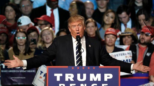 "FILE - In this Tuesday, Nov. 8, 2016 file photo, Republican presidential candidate Donald Trump speaks at a campaign rally in Grand Rapids, Mich. In a new book, Megyn Kelly says Trump tried unsuccessfully to give her a free hotel stay as part of what she called his pattern of trying to influence news coverage of his presidential campaign. In ""Settle for More,"" to be released Tuesday, Nov. 15, 2016, Kelly also said Trump may have gotten a pre-debate tip about her first question, in which she confronted him with his critical comments about women."