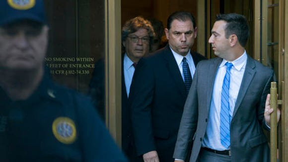 Joseph Percoco, center right, a former executive deputy secretary to Gov. Andrew Cuomo, leaves federal court in New York Thursday, Sept. 22, 2016. Federal authorities accused Percoco of soliciting more than $300,000 in bribes from an energy company and a Syracuse developer.