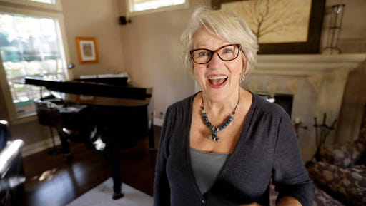"""Gayla Peevey, singer of that enduring Christmas classic, """"I Want a Hippopotamus For Christmas,"""" sings in her home Wednesday, Dec. 14, 2016, in La Mesa, Calif. It was 1953, and one of the hottest songs on the radio was   """"I Want a Hippopotamus For Christmas."""" Now it's Christmas 2016, and Peevey is still singing. She leaves that to schoolchildren, ringtones, iTunes downloads and TV commercials that, to the 73-year-old singer's amazement, keep the song in everyone's head every Christmas season, whether they want it there or not ."""