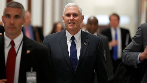 Vice President-elect Mike Pence walks through the halls of Russell Senate Office Building on Capitol Hill in Washington, Tuesday, Jan. 17, 2017. (AP Photo/Carolyn Kaster)