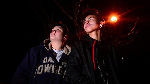 In this Nov. 29, 2016 photo, transgender high school students K'la Nieto, left, a senior at West Mesa High School,and Devin Mares, a senior at Atrisco Heritage Academy pose in Albuquerque.